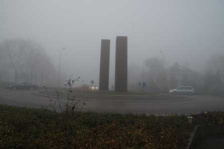 "Sculptures in the fog. ""De Poort van Bergen"" from Herbert Nouwens."